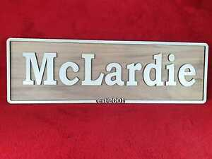 wooden family surname plaque wall mounted or free standing (feet and wall fittin