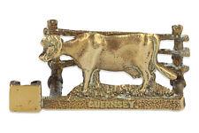 A vintage brass Guernsey cow letter holder