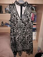 BNWT Size 10 gorgeous overlaid lacy dress in black and peach by Parisian