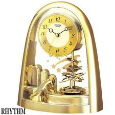 Rhythm 7607/9 Horloge de table quartz pendule rotatif, boîtier couleur d'OR