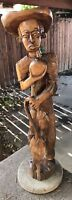 Large Early 20th Century Haitian Wood Carving - Boy Eating Fruit with Fish