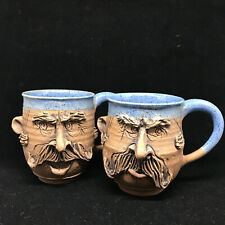 2 Vintage David L. Davis Hand Carved Face Mustache Mugs Artisan Pottery Signed