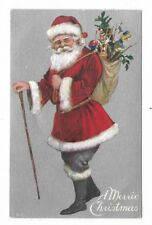 SANTA in red coat with white trim, green pants, walking stick, bag of toys