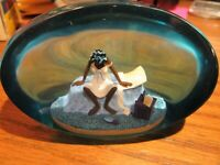 Lucite Paper Weight Lady sitting on the bed 4'' by 2 1/2''  Blue tint