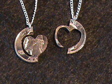 Hand Cut US Quartercoin with interlocking heart in a ring, with 2 24 inch silver