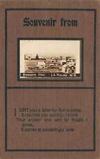 LA MOURE, ND, POSTCARD WITH ATTACHED REAL PHOTO OF TOWN OVERVIEW, dated 1911