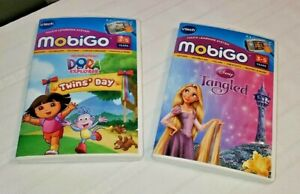 MobiGo  Touch & Learn Games Disney Tangled , Dora Twin's Day Lot of 2 by Vtech