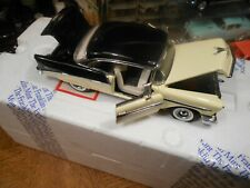 1/24 TH SCALE DIECAST OF A 1956 CHEVY BELAIR 2 DR. COUPE -- STIKING COLOR COMBO