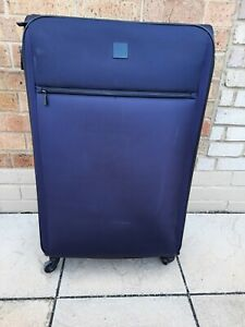 Large Tripp Suitcase, Full Circle 4 wheels, Grape colour With Padlock