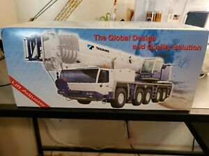 Tadano ATF 160G-5 with truck chassis in box no crane used.