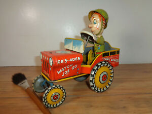 UNIQUE ART VINTAGE TIN & LITHOGRAPHED WINDUP G.I. JOE AND HIS JOUNCING JEEP