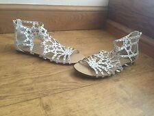 "River Island Flat (less than 0.5"") Gladiators Women's Shoes"