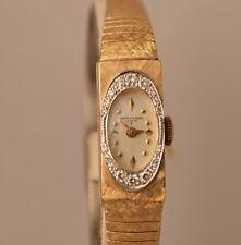 w376 14k gold  with  approx..25ct.tw. diammonds vintage  BAUME&MERCIER watch.