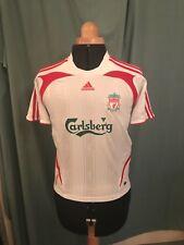 "Liverpool FC boys retro shirt. Size 28/30""  Sponsor Carlsberg."