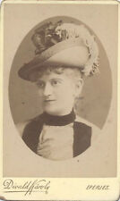 CDV PORTRAIT OF SMIRKING YOUNG WOMAN IN LARGE FLOWER HAT - BUDAPEST, HUNGARY