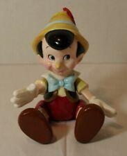 Walt Disney Co Schmid #254 Pinocchio Music Box Figure that sits or stands.