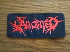 ABORTED  # 2,SEW ON RED EMBROIDERED PATCH