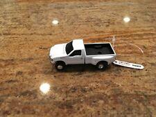 1/64 Ertl White Ford F 350 dual rear wheel pick up truck