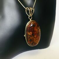 Vintage Oval Amber Pendant With Included Sterling Silver Necklace