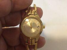 ladies Ak Anne Klein Goldtone bracelet watch with date new battery.
