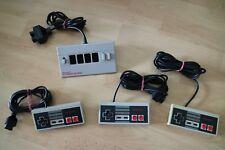 Nintendo NES original Controller und Nintendo NES Four Score Adapter