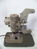 Vintage Bell & Howell Model 122-LR Movie Projector works fine, inludes manual