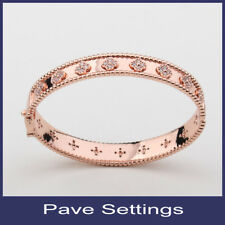 oval bangle with small cubic four leaf clover bracelet in rose gold