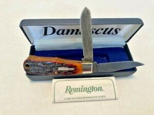 Remington R1173-D Damascus Sterling silver Bullet knife. New In Box Made 1998.
