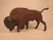 Large Lineol Buffalo / Bison walking with raised foot