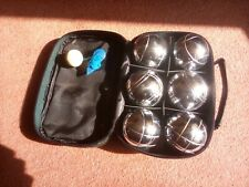 Boules set, metal with wooden jack and measure in carry case.