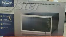 NEW Oster OGCMDM11S2-10 Microwave Oven 1.1 cu. ft. 1000 Watts Black / Silver
