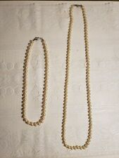 Two authentic white pearl matching necklaces