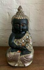 small sitting Buddha statue