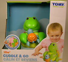 TOMY PRODUCED CUDDLE & GO PLASTIC PLAY TURTLE FOR YOUNG CHILDREN AGES 18M UP