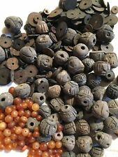 VINTAGE ETHNIC CARVED CLAY BEADS, UNGLAZED. GOLD BEADS AMBER? LOOSE. ESTATE
