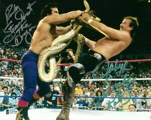 WWE STEAMBOAT AND ROBERTS HAND SIGNED AUTOGRAPHED 8X10 PHOTO WITH BECKETT COA