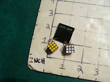 Vintage Cube puzzle: CUBE EARINGS, turn one way, on card 1982