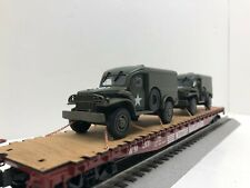 LIONEL 50' flat car with 2 Dodge Green Army Vehicles