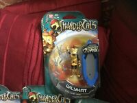 THUNDERCATS WILCAT FIGURE WITH BLUE BOARD NEW SEALED PACK HAS WEAR