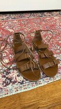 like new, worn once, leather gladiator, size 8
