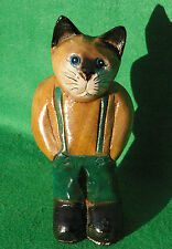 CARVING OF A STANDING CAT IN GREEN DUNGEREES  IN STAINED AND PAINTED WOOD