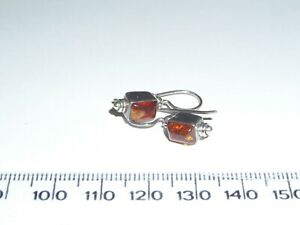 Silver earrings 925 set with square amber stone.