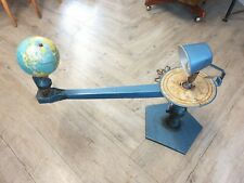 More details for a vintage planetarium orrery showing earth and moon phases around the sun