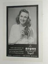 1945 ARGUS Camera advertisement, Argus Argoflex reflex camera, pretty girl