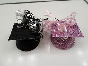 BLACK AND PINK GLITTER GRADUATION BALLOON WEIGHTS - USED ONCE - PARTY CITY