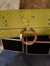Two Guess clutches green new with tags, tan pre-loved. Very elegant.