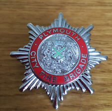 An old , Plymouth City   Fire Brigade, cap badge.