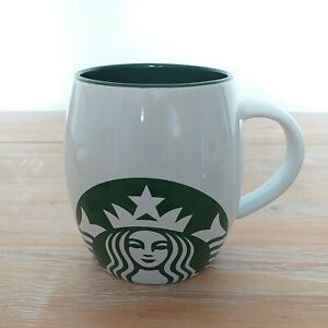 Starbucks Barrel Mug. White with mermaid design on front and green inside 2014.