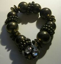 Bracelet elasticated bronze tone metal beaded with white stone decorated bead