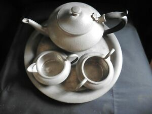 Tudric Arts & Crafts pewter tea set comprising tray, teapot, sugar bowl and jug
